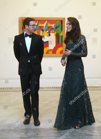 Catherine Duchess of Cambridge (R) is escorted by Nicholas Cullinan, gallery director