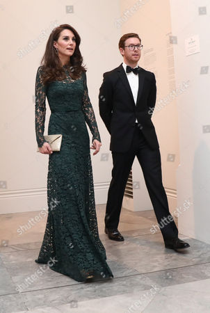 Catherine Duchess of Cambridge (L) is escorted by Nicholas Cullinan, gallery director at the 2017 Portrait Gala at the National Portrait Gallery in London