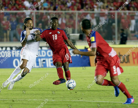 Panama's Luis Tejada, center, passes the ball as he is challenged by United States' Jermaine Jones, left, during a 2018 World Cup qualifying soccer match in Panama City