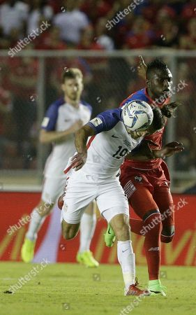 United States' Graham Zusi fight for the ball with Panama's Abdiel Arroyo, right, during a 2018 World Cup qualifying soccer match in Panama City