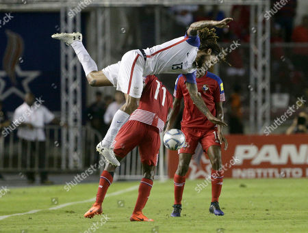 United States' Jermaine Jones, left, fights for the ball with Panama's Armando Cooper, center, and Adolfo Machado during a 2018 World Cup qualifying soccer match in Panama City