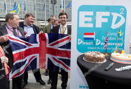 Scottish UKIP member David Coburn, left, holds a Brisith flag as h celebrates the official triggering of Article 50 of the Lisbon Treaty in Brussels on . EU Council President Donald Tusk has received a letter from British Prime Minister Theresa May, invoking Article 50 of the bloc's key treaty, the formal start of exit negotiations