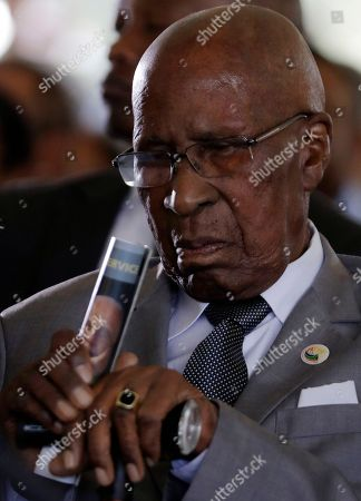 Andrew Mlangeni, a South African political activist and Anti-Apartheid campaigner who, along with Nelson Mandela and others, was held as part of the Rivonia Trial, attends the funeral service for Ahmed Kathrada, at West Park Cemetery in Johannesburg, South Africa, . Anti-apartheid activist Ahmed Kathrada, who spent 26-years in jail, many of them alongside Nelson Mandela, for working to end South Africa's previous white minority rule, died in Johannesburg on Tuesday morning. He was 87 years old
