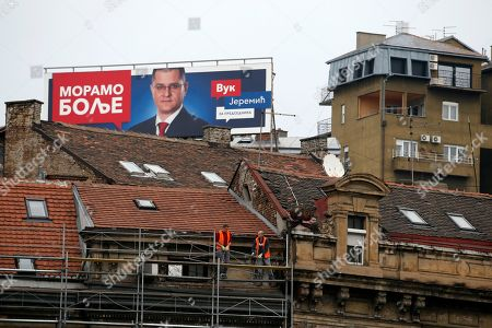 "A billboard on the roof showing presidential candidate Vuk Jeremic, reading: ""We must do better"", in Belgrade, Serbia, . Sasa Jankovic and Vuk Jeremic, two main opposition candidates differ on many things, but they agree on one: the campaign ahead of Serbian presidential election is the dirtiest since the votes that kept former strongman Slobodan Milosevic in power in the 1990s"