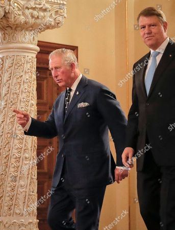 Britain's Prince Charles, left, walks with Romanian President Klaus Ioannis at the Cotroceni Presidential Palace in Bucharest, Romania, . Britain's Prince Charles has arrived in Bucharest at the start of a nine-day tour to Romania, Italy and Austria that the British government hopes will reassure European Union nations that Britain remains a close ally despite its intention to quit the bloc
