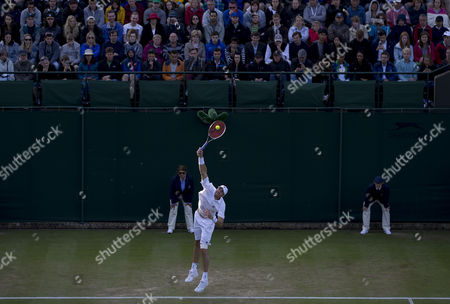 John Isner (USA) serves during his match with Matthew Barton (AUS). The Championships 2016 at The All England Lawn Tennis Club.