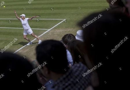 Stock Image of Martina Navratilova (USA) serves, with her partner Selima Sfar (TUN), during her Ladies' Invitational Doubles match with Helena Sukova (CZE) and Jana Novotna (CZE) The Championships 2016 at The All England Lawn Tennis Club.