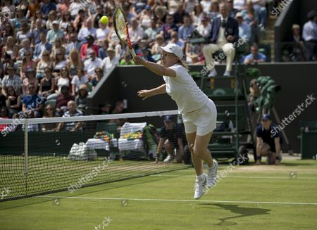 Stock Picture of Martina Navratilova (USA) dives for the ball, with her partner Selima Sfar (TUN), during her Ladies' Invitational Doubles match with Helena Sukova (CZE) and Jana Novotna (CZE) The Championships 2016 at The All England Lawn Tennis Club.