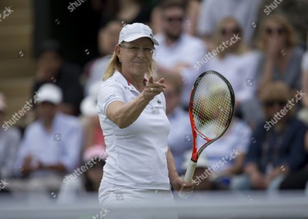 Martina Navratilova (USA) during her Ladies' Invitational Doubles match, serves, with her partner Selima Sfar (TUN), against Helena Sukova (CZE) and Jana Novotna (CZE) The Championships 2016 at The All England Lawn Tennis Club.