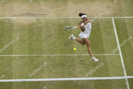 Heather Watson (GBR) returns during her Mixed Doubles match, with her partner Henri Kontinen (FIN) against Scott Lipspy (USA) and Alla Kudryavtseva (RUS). The Championships 2016 at The All England Lawn Tennis Club.