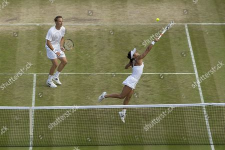 Heather Watson (GBR) jumps to return, with Henri Kontinen (FIN), against Scott Lipspy (USA) and Alla Kudryavtseva (RUS) in the returns during her Mixed Doubles match point. The Championships 2016 at The All England Lawn Tennis Club.