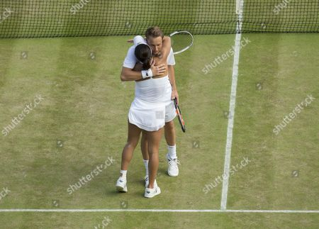 Heather Watson (GBR) and Henri Kontinen (FIN) celebrate match point against Scott Lipspy (USA) and Alla Kudryavtseva (RUS) in the returns during her Mixed Doubles match point. The Championships 2016 at The All England Lawn Tennis Club.