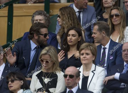 Actor Bradley Cooper, with his girlfriend, model Irina Shayk, talks to former Wimbledon champion Stefan Edberg before the GentlemenÕs Singles final match. The Championships 2016 at The All England Lawn Tennis Club.