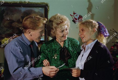 Stock Photo of Sheila Mercier (as Annie Kempinski) with Craig McKay (as Mark Hughes) and Glenda McKay (Rachel Hughes) as Annie gives Mark and Rachel £5,000 each to spend on whatever they want (Ep 1827 - 21st December 1993)
