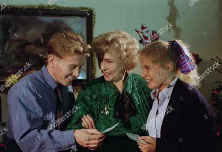 Sheila Mercier (as Annie Kempinski) with Craig McKay (as Mark Hughes) and Glenda McKay (Rachel Hughes) as Annie gives Mark and Rachel £5,000 each to spend on whatever they want (Ep 1827 - 21st December 1993)