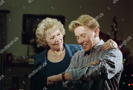 Sheila Mercier (as Annie Kempinski) with Craig McKay (as Mark Hughes) as the Sugden family exchange gifts, as Annie gives Jacob's gold watch to Mark (Ep 1828 - 23rd December 1993)