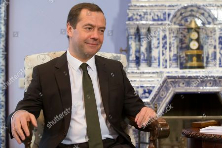 Russian Prime Minister Dmitry Medvedev smiles as he listens to Belarus' Prime Minister Andrei Kobyakov during their meeting in the Gorky residence outside Moscow, Russia