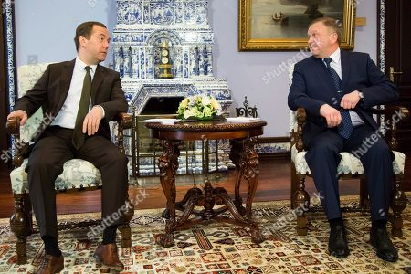 Dmitry Medvedev, Andrei Kobyakov Russian Prime Minister, Dmitry Medvedev, left, looks towards Belarus' Prime Minister, Andrei Kobyakov, prior to their talks in the Gorky residence outside Moscow, Russia, . Russian and Belarus officials discussed a host of energy disputes that have strained ties between the two neighbors and allies