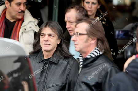 Angus Young, Malcolm Young and Phil Rudd