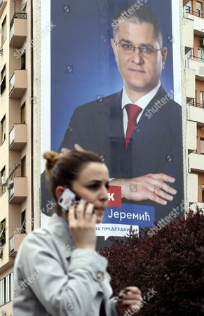 A woman walks by the billboard of candidate for the Serbian presidency, Vuk Jeremic, in Belgrade, Serbia, 30 March 2017. Serbian presidential elections will be held on 02 April 2017.