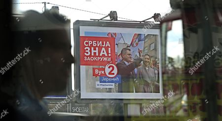 Billboards seen through a bus of candidates for the Serbian presidency, Vojislav Seselj (L) and Vuk Jeremic (R) in Belgrade, Serbia, 30 March 2017. The Serbian Presidential election is scheduled to take place on 02 April 2017.