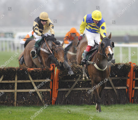 The John Smith's Great Float Social Club Liverpool Hurdle Race.(R) Blazing Bailey (Robert Thornton) takes the last before going on to win from (L) 3rd placed Inglis Drever (Denis O'Regan).
