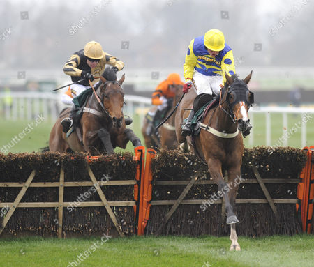 Stock Photo of The John Smith's Great Float Social Club Liverpool Hurdle Race.(R) Blazing Bailey (Robert Thornton) takes the last before going on to win from (L) 3rd placed Inglis Drever (Denis O'Regan).