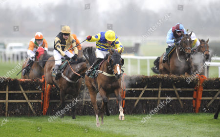 The John Smith's Great Float Social Club Liverpool Hurdle Race.(C) Blazing Bailey (Robert Thornton) takes the last before going on to win from (L) 3rd placed Inglis Drever (Denis O'Regan).