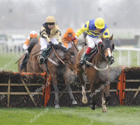 Stock Image of The John Smith's Great Float Social Club Liverpool Hurdle Race.(R) Blazing Bailey (Robert Thornton) takes the last before going on to win from (L) 3rd placed Inglis Drever (Denis O'Regan).