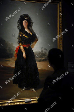 A visitor looks at the painting 'The Duchess of Alba', by Spanish artist Francisco de Goya, during the presentation of the exhibition 'Visions of the Hispanic World. Treasures from the Hispanic of America' at Museo del Prado museum in Madrid, Spain, 31 March 2017. The exhibition, running from 04 April to 10 September 2017, features more than 200 artworks belonged to Hispanic Society of America.