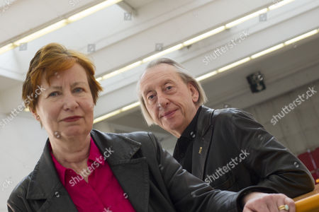 British authors Mary Talbot (L) and her husband Bryan Talbot pose for photographers during the presentation of their graphic work 'The Red Virgin' at the Barcelona International Comic Fair, in Barcelona, northeastern Spain, 31 March 2017. The 35th FICOMIC Fair runs from 30 March to 02 April.