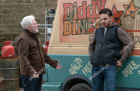 Stock Picture of Ronnie, as played by John McArdle, is taken aback by Adam Barton's, as played by Adam Thomas, foul mood and encourages him to open up. As Adam pushes him away Ronnie retaliates and Adam falls. Will Ronnie comfort a tearful Adam? (Ep 7803 - Wed 19 April 2017)