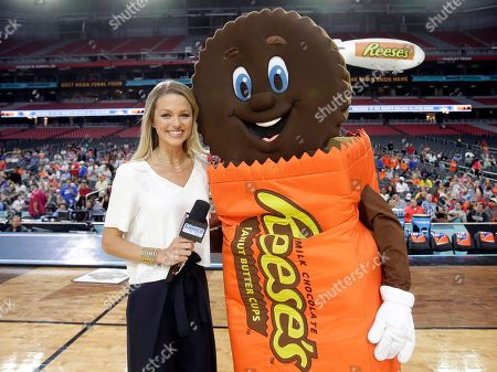 CBS Sideline Reporter, Allie LaForce, poses with Reese's brand mascot, Cuppy, at the Reese's College All-Star Game at University of Phoenix Stadium, in Glendale, Ariz. Reese's brand is the Official Candy Partner of the NCAA