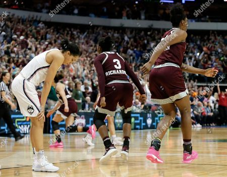 Teaira McCowan, Breanna Richardson, Gabby Williams Connecticut guard Gabby Williams, left, stands on the court as Mississippi State's Breanna Richardson (3) and Teaira McCowan, right, celebrate their 66-64 win in an NCAA college basketball game in the semifinals of the women's Final Four, in Dallas