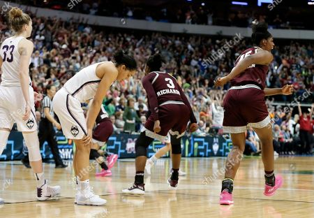 Breanna Richardson, Teaira McCowan, Katie Lou Samuelson, Gabby Williams Connecticut's Katie Lou Samuelson (33) and Gabby Williams, second from left, walk off the court as Mississippi State's Breanna Richardson (3) and Teaira McCowan, right, celebrate their 66-64 overtime win in an NCAA college basketball game in the semifinals of the women's Final Four, in Dallas