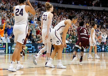 Breanna Richardson, Napheesa Collier, Katie Lou Samuelson, Gabby Williams Connecticut's Napheesa Collier (24), Katie Lou Samuelson (33) and Gabby Williams, third from left, walk off the court as Mississippi State's Breanna Richardson (3) celebrates their 66-64 overtime win during an NCAA college basketball game in the semifinals of the women's Final Four, in Dallas