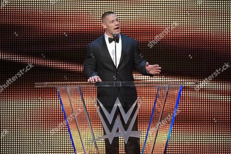 IMAGE DISTRIBUTED FOR WWE - John Cena inducts Kurt Angle into the WWE Hall of Fame as part of the WrestleMania 33 weekend during a ceremony, in Orlando, Fla