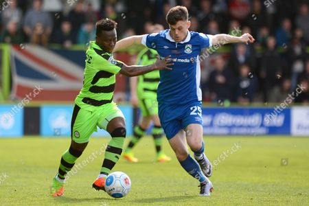Forest Green Rovers midfielder Drissa Traore (4) and North Ferriby United forward Reece Thompson (25) battle for possession 0-0 during the Vanarama National League match between Forest Green Rovers and North Ferriby United at the New Lawn, Forest Green