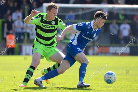 Forest Green Rovers defender Mark Ellis (5) holds up North Ferriby United forward Reece Thompson (25) 0-0 during the Vanarama National League match between Forest Green Rovers and North Ferriby United at the New Lawn, Forest Green