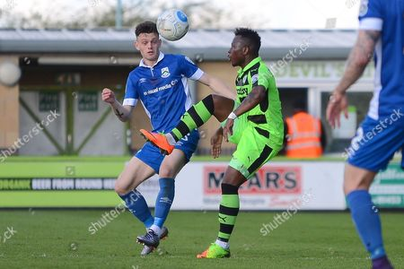 Stock Picture of Forest Green Rovers midfielder Drissa Traore (4) takes on North Ferriby United forward Reece Thompson (25) 0-0 during the Vanarama National League match between Forest Green Rovers and North Ferriby United at the New Lawn, Forest Green