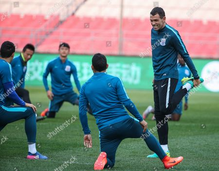 Shanghai Shenhua head coach Gus Poyet (R) and his player Carlos Tevez (2-R) during a training session at the Workers Stadium in Beijing, China, 01 April 2017. Shanghai Shenhua will face Beijing Guoan in the Chinese Super League soccer match at the Workers Stadium in Beijing on 02 April 2017.
