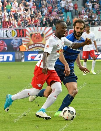Leipzig's Naby Keita, left, challenges for the ball with Darmstadt's Hamit Altintop, right, during the German first division Bundesliga soccer match between RB Leipzig and SV Darmstadt 98 in Leipzig, Germany