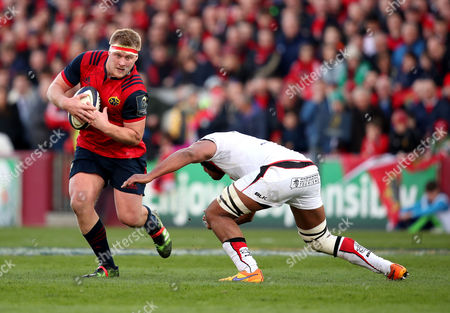 Stock Photo of Munster vs Toulouse. Munster's John Ryan with Thierry Dusautoir of Toulouse