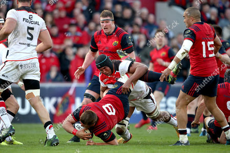 Munster vs Toulouse. Munster's CJ Stander tackled by Thierry Dusautoir of Toulouse