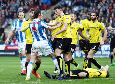 Tom Flanagan of Burton Albion and Dean Whitehead of Huddersfield Town square up to each other in an incident that led to Whitehead been sent off during the Sky Bet Championship match between Huddersfield Town and Burton Albion played at the John Smith's Stadium, Huddersfield, on 1st April 2017