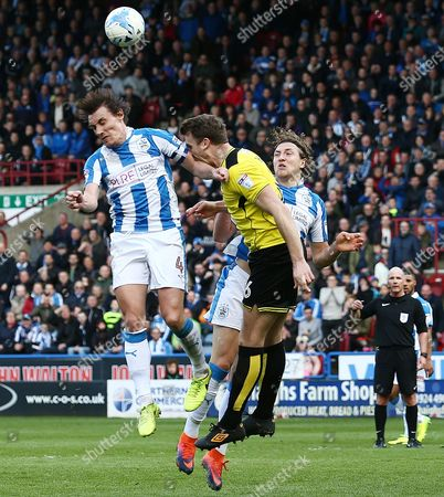 Ben Turner of Burton Albion collides with Dean Whitehead of Huddersfield Town in an incident that led to Whitehead been sent off during the Sky Bet Championship match between Huddersfield Town and Burton Albion played at the John Smith's Stadium, Huddersfield, on 1st April 2017