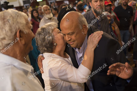 Sacked former Finance Minister Pravin Gordhan greets Barbara Hogan, wife of Ahmed Kathrada  during Kathrada's public memorial service in Johannesburg, South Africa, 01 April 2017. Kathrada, an anti-apartheid struggle icon and close friend of the late former South African President, Nelson Mandela died on 28 March. The memorial was supposed to be hosted by the President Zuma led government but was cancelled by them suddenly, leaving the Nelson Mandela Foundation, the South African Communist Party and the Ahmed Kathrada Foundation to host the event.