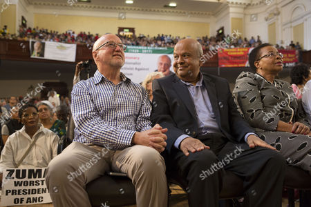 Sacked former Finance Minister Pravin Gordhan (2-R) flanked by former cabinet minister, Derek Hanekom (L) and Graca Machel (R), the wife of the late former South African President, Nelson Mandela join supporters of late anti-apartheid activist Ahmed Kathrada at his public memorial service in Johannesburg, South Africa, 01 April 2017. Kathrada, an anti-apartheid struggle icon and close friend of the late former South African President, Nelson Mandela died on 28 March. The memorial was supposed to be hosted by the President Zuma led government but was cancelled by them suddenly, leaving the Nelson Mandela Foundation, the South African Communist Party and the Ahmed Kathrada Foundation to host the event.