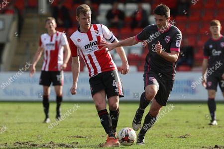 Kyle Storer and Peter Murphy during the EFL Sky Bet League 2 match between Cheltenham Town and Morecambe at Whaddon Road, Cheltenham