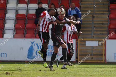 Emmanuel Onarise and Peter Murphy during the EFL Sky Bet League 2 match between Cheltenham Town and Morecambe at Whaddon Road, Cheltenham